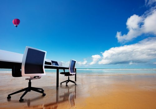 Office table and chairs, remote work beach concept